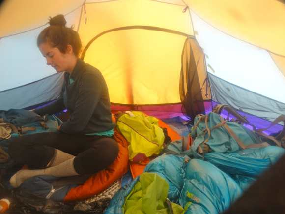 Chrissy inside our tent at the end of a long day