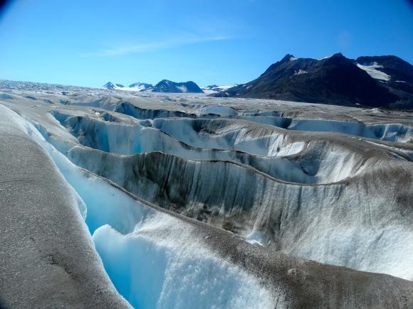 The glacier gets more broken up with larger crevasses